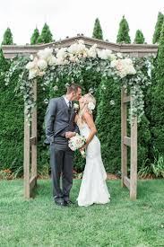 asheville wedding ceremony arch wooden arbor white hydrangeas eucalyptus leaves
