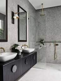 the layout in alisa and lysandra s bathroom renovation allows for plentiful storage in a y on trend black tone picture lisa cohen photography