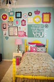 make a wall collage with hanging picture frames