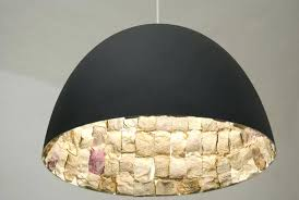 unique pendant lighting. Unique Pendant Lights Matte Black Metal Shade Light With Stony Interior  Wall Texture Yellow Glow Unusual . Lighting