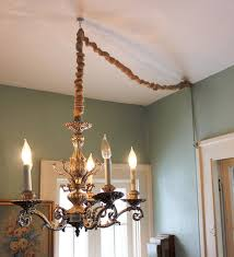 hang a chandelier without hardwiring by converting to a lamp and then covering the cord