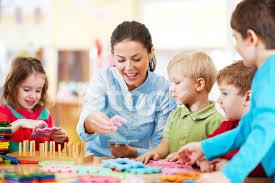Nursery Teacher Nursery Teacher Playing With The Kids Stock Photos Freeimages Com