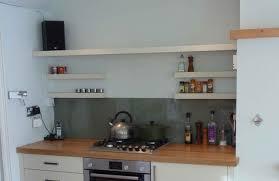 splendid white wooden wall mount bracketless shelves above glossy brown kitchen countertop on white wall amazing wall mounted kitchen shelves ideas