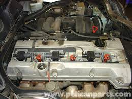 mercedes benz w210 spark plug replacement 1996 03 e320 e420 once the insert piece is removed you ll see the ignition coils and wires