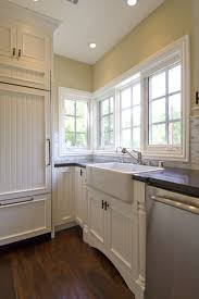 white beadboard bedroom cabinet furniture. Gorgeous Kitchen With Pale Yellow Walls, Creamy White Beadboard Cabinets, Black Countertops, Carrara Marble Subway Tile Backsplash And Farmhouse Sink. Bedroom Cabinet Furniture