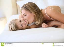Mother Giving A Kiss To Her Daughter Laid On Bed Stock Photo   Image Of  Little, Child: 47990614