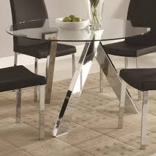 wonderful small glass dining table 21 round on top with metal legs and black chairs