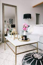 A coffee table is the focus of any living room furniture layout and creates the perfect spot for entertaining. This Tiny San Francisco Apartment Is Our Bachelorette Dream The Everygirl Decor Apartment Decor White Furniture Living Room