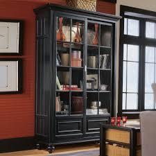 tall bookshelves with doors
