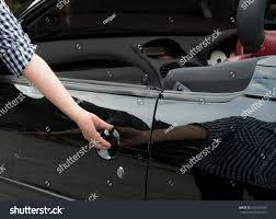 car door handle hand. Perfect Car Girlu0027s Hand Pulling A Caru0027s Door HandleWoman Open Black Car With  Empty For Car Door Handle Hand Q