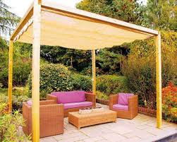 stylish wooden pergola and stamped patio floor for simple backyard landscaping ideas with brown square shaped wicker sofa set