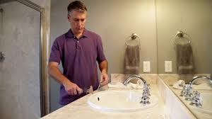 how to remove caulk from a shower sink or bathtub