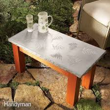 this diy outdoor table has an endless list of possibilities for decorating the concrete top we love the leaves but they have lots of other ideas for you