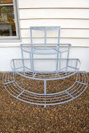 four tier wrought iron plant stand