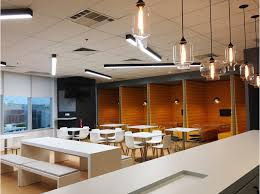 office pendant light. Pendant Light Glass Shapes Hang Harmoniously Together. The Breakroom Space Features Bright Yellow Accent Walls And Black White Geometric Tile Office
