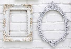 vintage picture frames on white brick wall background stock photo 34921823