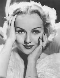 carole lombard is the epitome of 1930s hollywood glam in this image from 1935 her