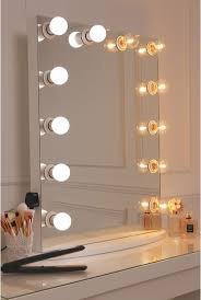 vanity mirror with a pure white finish framed with 12 led golf size light bulbs