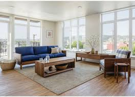 traditional living room furniture stores. clyde sofa in eastern walnut shown iwth lounge chair, sebastian end table, modern coffee and celilo media console. traditional living room furniture stores e