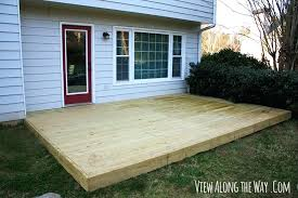 new wooden deck at view along the way over concrete patio vs cost and cover