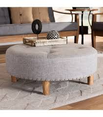 round light grey tufted fabric ottoman