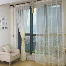 bedroom or living room white sheer curtains with light yellow patterns