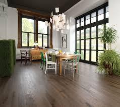 sun room with rustic barn wood red oak hardwood floor by mirage