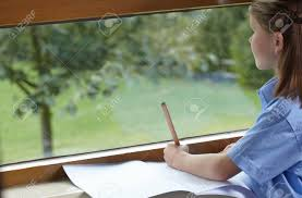 classroom window. School Girl Holding A Pencil And Staring Out Of Classroom Window Stock Photo - 86290701