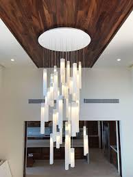 High ceiling lighting fixtures Wooden Modern Foyer Chandelier Specially Designed For Entrance Or Staircase Lighting High Ceiling Lighting Foyer Chandelier Modern Foyer Foyer Pinterest Modern Foyer Chandelier Specially Designed For Entrance Or