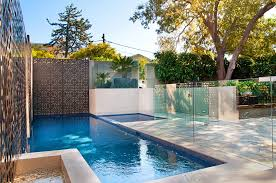 Modern Backyard Design Ideas Captivating Brown Wall Accent Stylish Glass  Deck Railing Cream Marble Plunge Pool Borders L Shape Swimming Pool  Decoration
