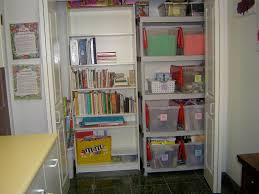 enticing craft closet designed by white wooden shelves and storage having white wooden doors on the stylish craft closet organization ideas
