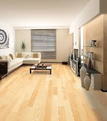 gorgeous maintaining wood floors with shiny oak wood flooring over the white shceme furniture living room