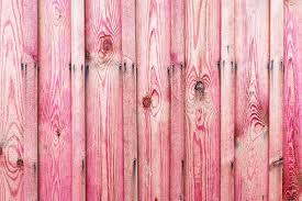 A fragment of a wooden fence Wooden boards as a background with