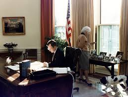 george bush oval office. President George H. W. Bush, First Lady Barbara Bush And Millie The Family Dog In Oval Office. Office D