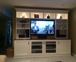 white ikea besta entertainment center with recessed lighting and shelves also cabinet