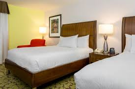 a bed or beds in a room at hilton garden inn fort worth fossil creek