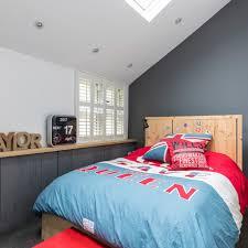 Dark grey teenage boy's bedroom with statement duvet set