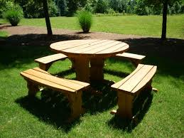 round picnic table with umbrella