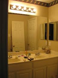 vanity bathroom lighting. awesome vanity painted in white enlightened by simple bulb bathroom lights combined with twin oval lighting t