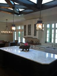 black polished iron frame cage chandelier using one bulbs over black wooden kitchen island endearing