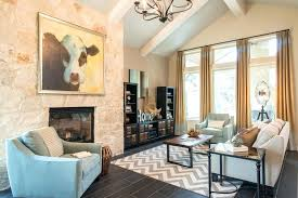 dark gray rug living room grey chevron rug family room transitional with coffee table cow painting