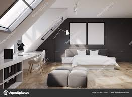 Bedroom Interior With A Wooden Floor And White And Gray Brick Walls. There  Is A Double White And Gray Bed And A Home Office Part With A Computer Desk  And ...