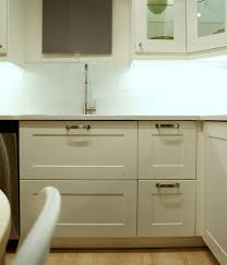 i noticed a few other interesting design elements like open shelf base cabinets and freestanding units made up of cabinets legs