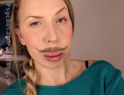 maker of the eyeball lips makeup is a cornucopia of wonderful optical illusions from a distance it looks like she s sporting a dapper mustache