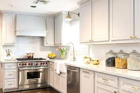 how to clean brass hardware on kitchen cabinets pale grey transitional cabinet k