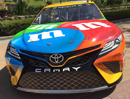 2018 toyota nascar. the front end of nascar camry followed by production model 2018 toyota nascar