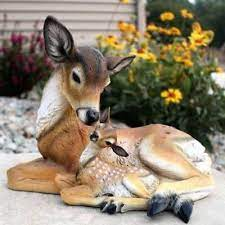 mother deer and baby fawn lying down