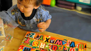 my 18 months old baby boy solving the Alphabet puzzle - YouTube