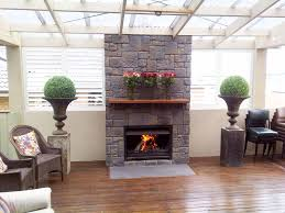 impressive fireplace surround ideas with marvelous gray stone tile fireplace surround and simple brown wooden fireplace