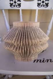 book folding tutorial one of my favorite tutorials from loren crane of pandora s craft box this book folding art is a great way to upcycle an old book